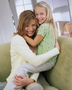 Mother and Daughter Hugging on a Chair